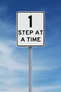 One step at a time modified speed limit sign indicating Royalty Free Stock Images