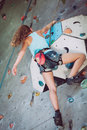 One teenager climbing a rock wall indoor. Royalty Free Stock Photo