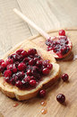 One toast with cranberry jam on wooden table Stock Image