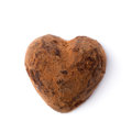 One truffle candy in a heart shape valentine s day closeup isolate on white shallow depth of field Stock Image
