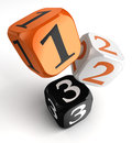 One two and three numbers on orange black dice blocks white background clipping path included Stock Photos