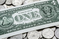 One USA Dollar Bill On A Pile Of Quarters Royalty Free Stock Photo