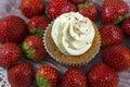 One vanilla cupcake with white cream and strawberries Royalty Free Stock Photo