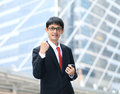 One very happy energetic businessman with his arms raised Stock Photo