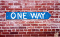 One-Way Sign on Brick Wall Royalty Free Stock Image