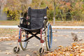 One wheelchair outdoors in the park a fall landscape Royalty Free Stock Photo