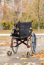 One wheelchair outdoors in the park a fall landscape Royalty Free Stock Photography