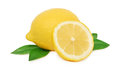 One whole and a half of ripe lemon with green leaves isolated on white background Stock Images