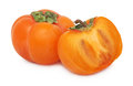 One whole and a half of ripe persimmon (isolated) Royalty Free Stock Images