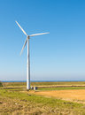 One wind turbine in a rural landscape Royalty Free Stock Photo