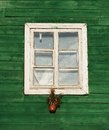 One window in vintage style in green wall background,architecture details. Colorful window fragment.Street scene with the house wi Royalty Free Stock Photo