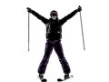 One woman skier skiing arms outstretched happy silhouette Royalty Free Stock Photo