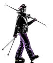 One woman skier walking silhouette caucasian in on white background Stock Photos