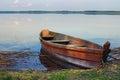 One wooden fishing boat on bank of the lake. Spring landscape photo. Lake Svityaz. Volyn region. Ukraine Royalty Free Stock Photo