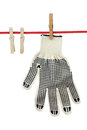 One working glove clothesline over white background Royalty Free Stock Photo