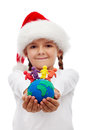 One world of happy people at christmas concept little girtl holding earth and made clay isolated Royalty Free Stock Photos