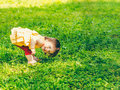 One-year baby girl playing upside down on the street Royalty Free Stock Photo