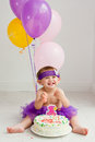 One year old birthday girl with cake Royalty Free Stock Photo