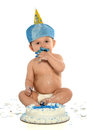 One year old boy with birthday cake hispanic eating over white background Stock Photography