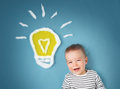 One year old boy and a bulb near. Child with an idea Royalty Free Stock Photo