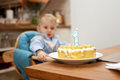 One year old boy looking his birthday cake Royalty Free Stock Images