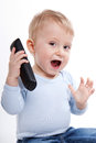 One year old boy with phone isolated Stock Images