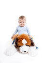 One year old boy playing teddy bear Royalty Free Stock Photos
