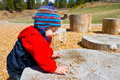One year old playing at park a boy plays a outdoors with wood chips and structures to keep him entertained Stock Photography