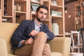 One young handsome man sitting sofa coffee bar indoors interior Royalty Free Stock Photo