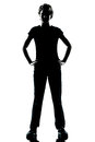 One young teenager boy or girl silhouette standing hands on hips Royalty Free Stock Photo