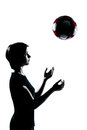 One young teenager girl silhouette tossing soccer football caucasian portrait in studio cut out isolated on white background Royalty Free Stock Image