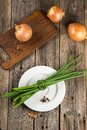 Onion and chive on old wood Stock Photos