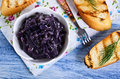 The onion confit in a ceramic dish in rustic style Royalty Free Stock Image