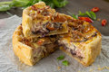 Onion pie with ham and cheese Stock Images
