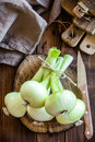 Onion raw on a wooden table Stock Photos