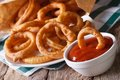 Onion rings in tomato sauce closeup. horizontal on the table Royalty Free Stock Photo