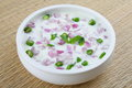 Onion salad in bowl delicious of and green chillies with yogurt Stock Image