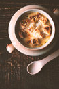 Onion soup in the ceramic pot  with spoon on the wooden table vertical Royalty Free Stock Photo