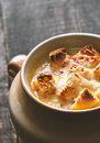 Onion soup in the ceramic pot vertical Royalty Free Stock Photo