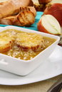 Onion soup with cheese croutons. Stock Photo