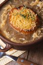 Onion soup with croutons and cheese macro top view Royalty Free Stock Photo