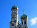 Onion towers st afra church the of the minor basilica ulrich augsburg germany a baroque architecture set against a blue sky Stock Photography