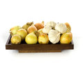 Onions and garlic presented on a wooden board Stock Image