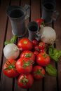 Onions and Tomatoes on wood table Stock Image