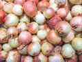 Onions yellow crop background close up Royalty Free Stock Images