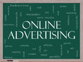 Online Advertising Word Cloud Concept on a Blackboard Stock Photo