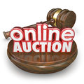 Online auction gavel internet bidding web site win buy item d words on a wood block with a closing the on an in an website Royalty Free Stock Images