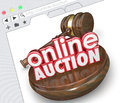 Online auction website internet online marketplace bidding selli d words with wood gavel on a screen or where buyers and sellers Stock Photo