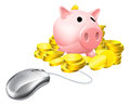 Online banking concept computer mouse connected to piggy bank with gold coins for savings or investments Stock Photo