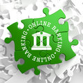 Online banking concept on green puzzle pieces business Royalty Free Stock Photos